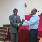 Menale handing over the project vehicle keys to EIAR's Dr Wolde at the EIAR offices in Addis Ababa