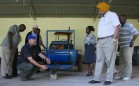 Project team members examining small scale tractor at the project launch in March 2013. Photo credit: CIMMYT