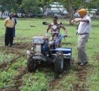 Project team demonstrating a two-wheeled tractor at the project launch. Photo: CIMMYT