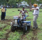 Project partners demonstrating two-wheeled tractors at project launch. Photo: CIMMYT