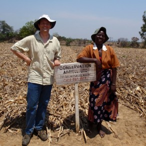 People standing next to a sign identifying a farm practising conservation agriculture, Malawi. (Photo: M Gyles ACIAR)